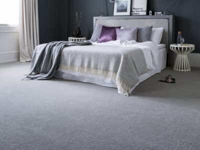 A bedroom with Sensation Atlantic Seal carpet